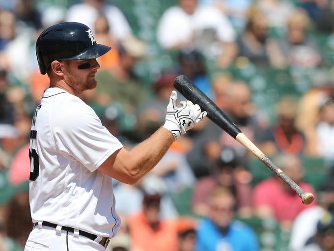 Tigers first baseman John Hicks tosses his bat after