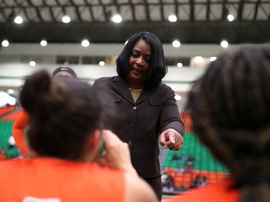 FAMU Head Coach LeDawn Gibson talks to her team during