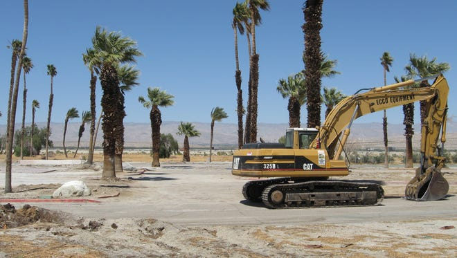 An excavator sits on the property that was once home to the Palm Springs Country Club clubhouse.
