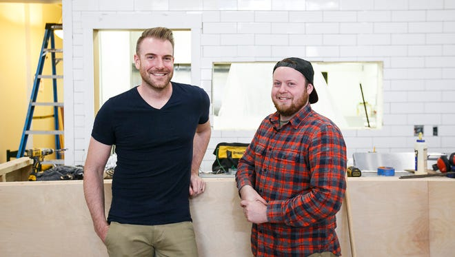 Brian Kaufman, left, and Matt Adams, right, stand at the counter in their soon-to-open burger bar Bo & Vine on Liberty Street in downtown Salem. They will open June 2, serving specialty burgers, including vegan and chicken options, with sides like sweet potato fries and boozy milkshakes.