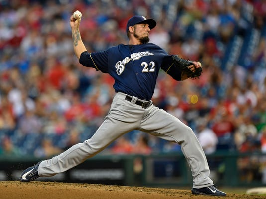 FILE - In this July 21, 2017, file photo, Milwaukee Brewers starting pitcher Matt Garza throws during the third inning of the team's baseball game against the Philadelphia Phillies in Philadelphia. Garza is scheduled to start for the Brewers on Thursday against the Washington Nationals.  (AP Photo/Derik Hamilton, File)