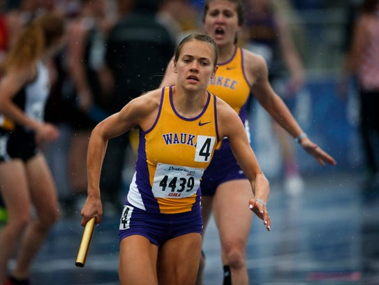 Waukee junior Lily Campbell takes the baton in the
