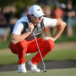 Rory McIlroy checks the fourth green during Round 3