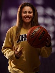 Maya McDermott of Johnston has been named to The Des Moines Register's All-CIML Elite girls basketball team. Here she poses for a portrait in the studio on Wednesday, Feb. 21, 2018, in Des Moines.