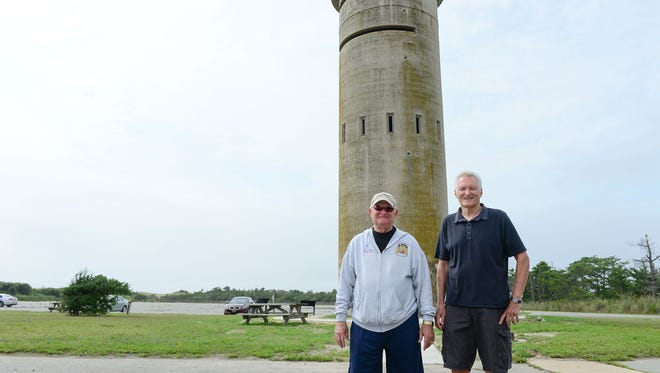 Gary Wray, the president of the Fort Miles Historical Association and Larry Brown, president of the Delaware Seashore Preservation Foundation stand in front of Fire Tower 3, just south of Dewey Beach. The tower will be completely sealed off from the elements, get a new staircase, a new Plexiglas door and some entertainment areas around it.