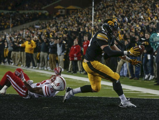 Despite being slowed by injuries, Iowa tight George