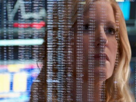 """Anna Gunn as Naomi Bishop in """"Equity,"""" which is directed by Park Ridge native Meera Menon."""