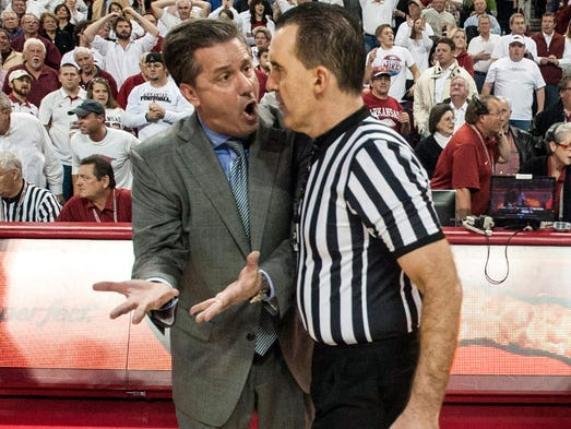 Kentucky Wildcats head coach John Calipari talks with a referee during a break in play against the Arkansas Razorbacks at Bud Walton Arena. Arkansas defeated Kentucky, 87-85, in overtime.