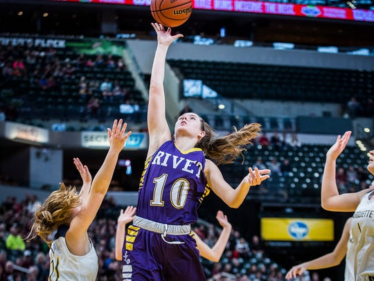 Vincennes Rivet's Tia Tolbert shoots over Michigan City Marquette Catholic's defense during the Class A girls' state championship game on Saturday.