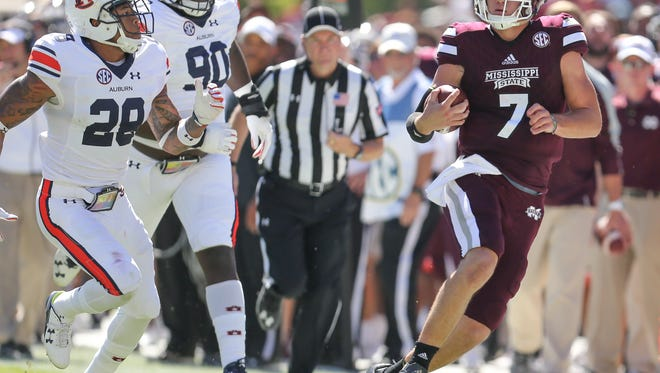 Mississippi State's Nick Fitzgerald (7) prepares to step out of bounds after picking up a first down. Mississippi State played Auburn in an SEC football game on Saturday, October 8, 2016 at Davis Wade Stadium in Starkville, MS. Photo by Keith Warren/For The Clarion-Ledger
