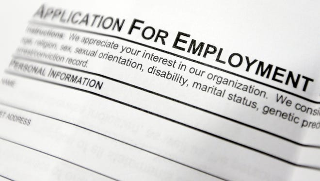 This file photo shows an employment application form.