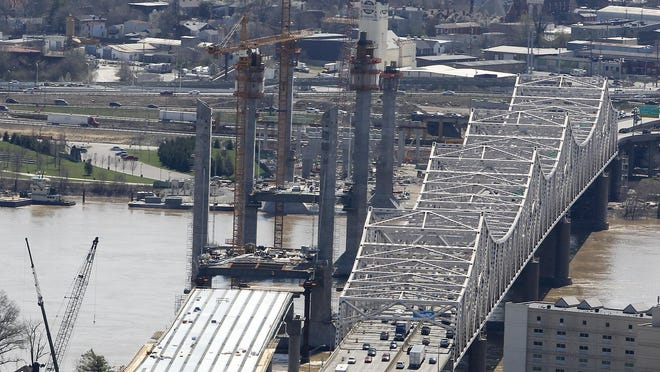 The towers for the new Downtown Crossing of the Ohio River Bridges Project rise next to the Kennedy Memorial Bridge.  April 4, 2015