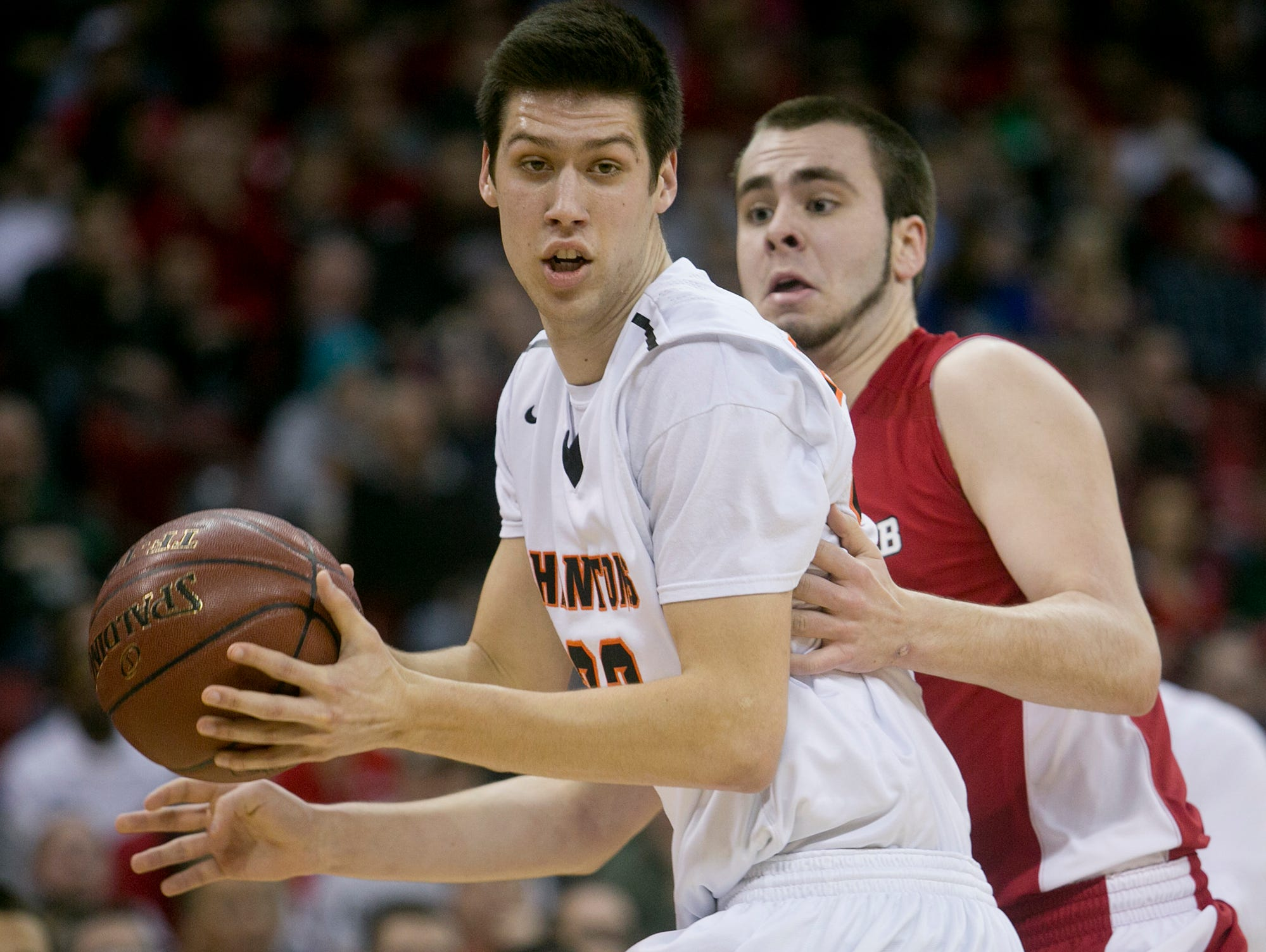 West De Pere's Cody Schwartz, left, against Mount Horeb's Terek Nesheim, right, in the Division 2 semifinal basketball game in the 100th annual WIAA State Boys Basketball Tournament at the Kohl Center on Friday, March 20, 2015, in Madison, Wis.