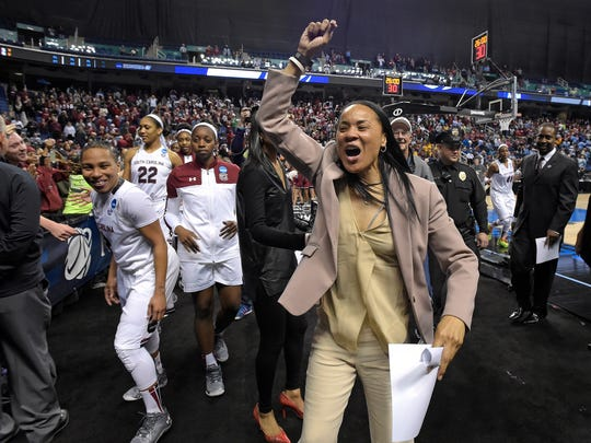 South Carolina head coach Dawn Staley celebrates the Gamecocks 67-65 win over North Carolina in the 3rd round of the NCAA Women's Tournament Friday, March 27, 2015 at the Greensboro Coliseum in Greensboro, N.C.