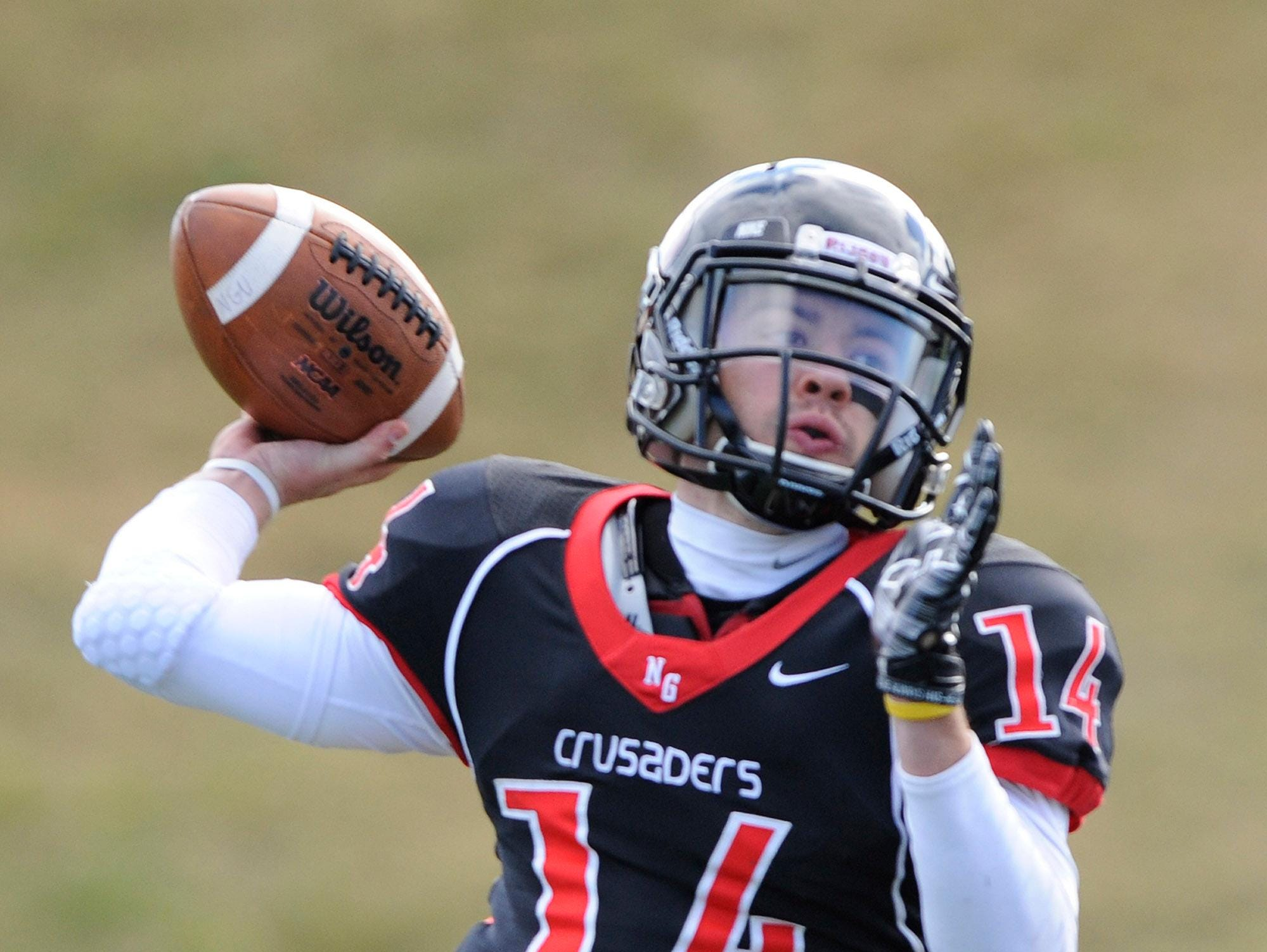 North Greenville's Nelson Hughes (14) passes against Wingate University in college football action Saturday, Nov. 1, 2014.