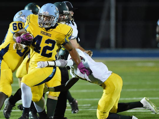 Capes 42 Kolbi Wright carries the ball as Cape Henlopen