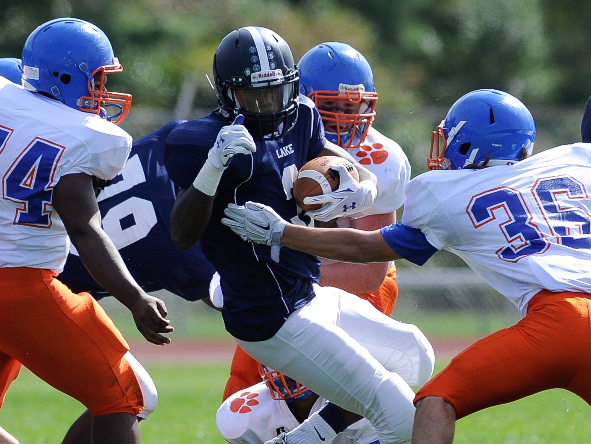 Lake Forest's #3 Trevor Milton runs the ball in their 19-14 win over Delmar on Saturday at Lake Forest High School.