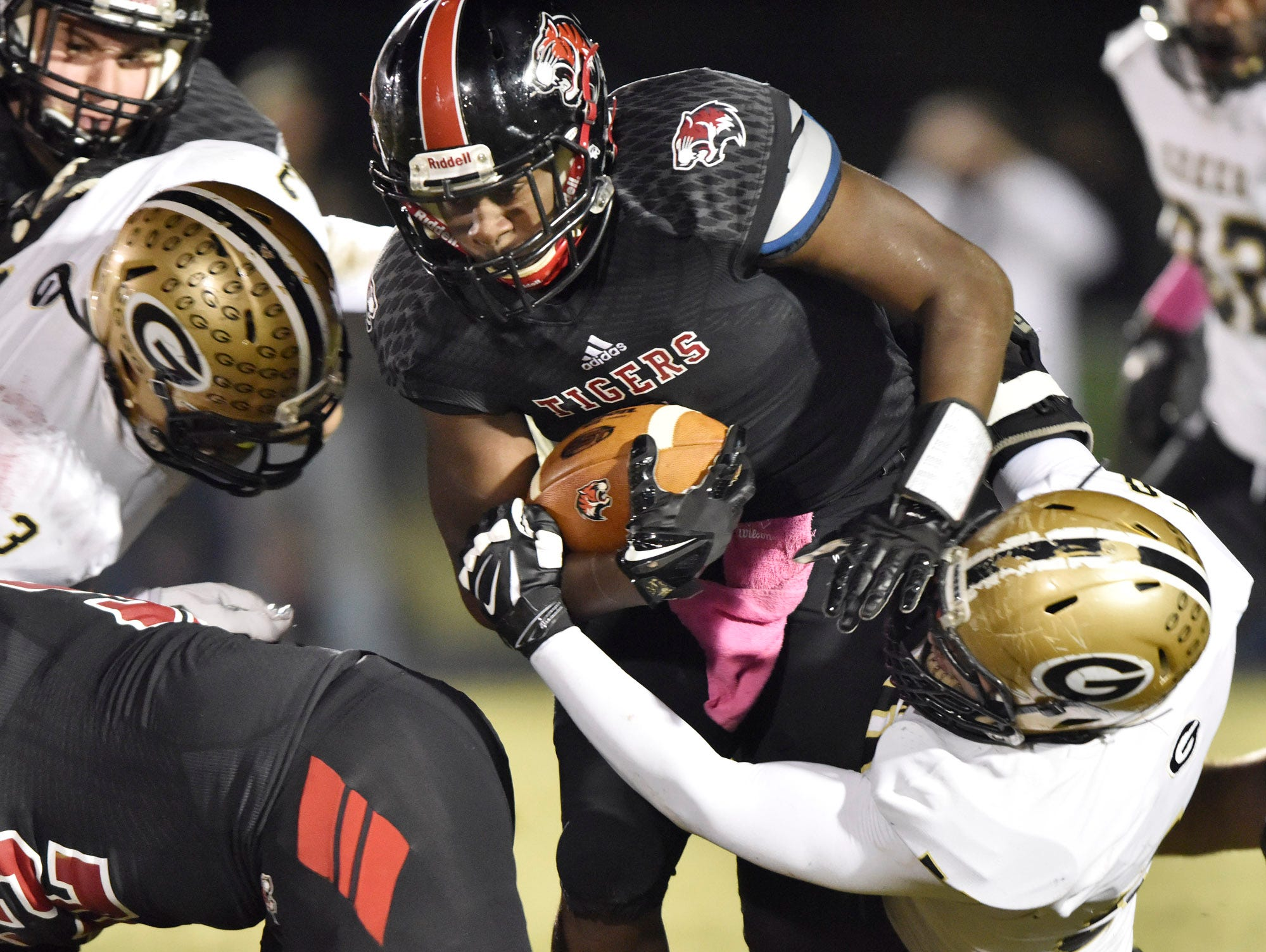 Blue Ridge's Vonta Jenkins (1) is caught by Greer's Quantavious Cohen (3) and Korey Styles (58).