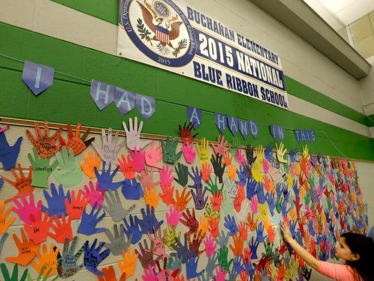 Buchanan Elementary third-grader Kaitlin Waters places