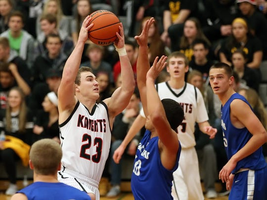 Hempfield's Will Blair (23) rises for a layup against Cedar Crest during the Black Knights' 63-59 home win Thursday.