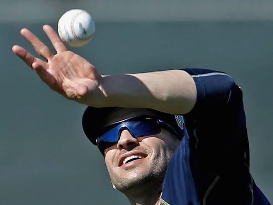 Milwaukee Brewers left fielder Ryan Braun catches a ball bare handed during a spring training workout.