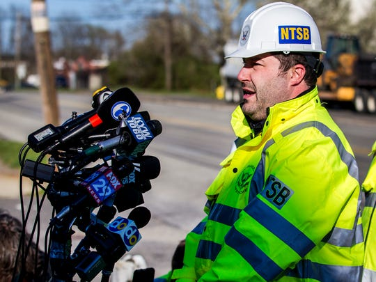 Ryan Frigo, Investigator-in-Charge for the National Transportation Safety Board (NTSB), speaks to members of the press near the scene of an Amtrak train derailment in Chester, Pa. on Sunday afternoon.