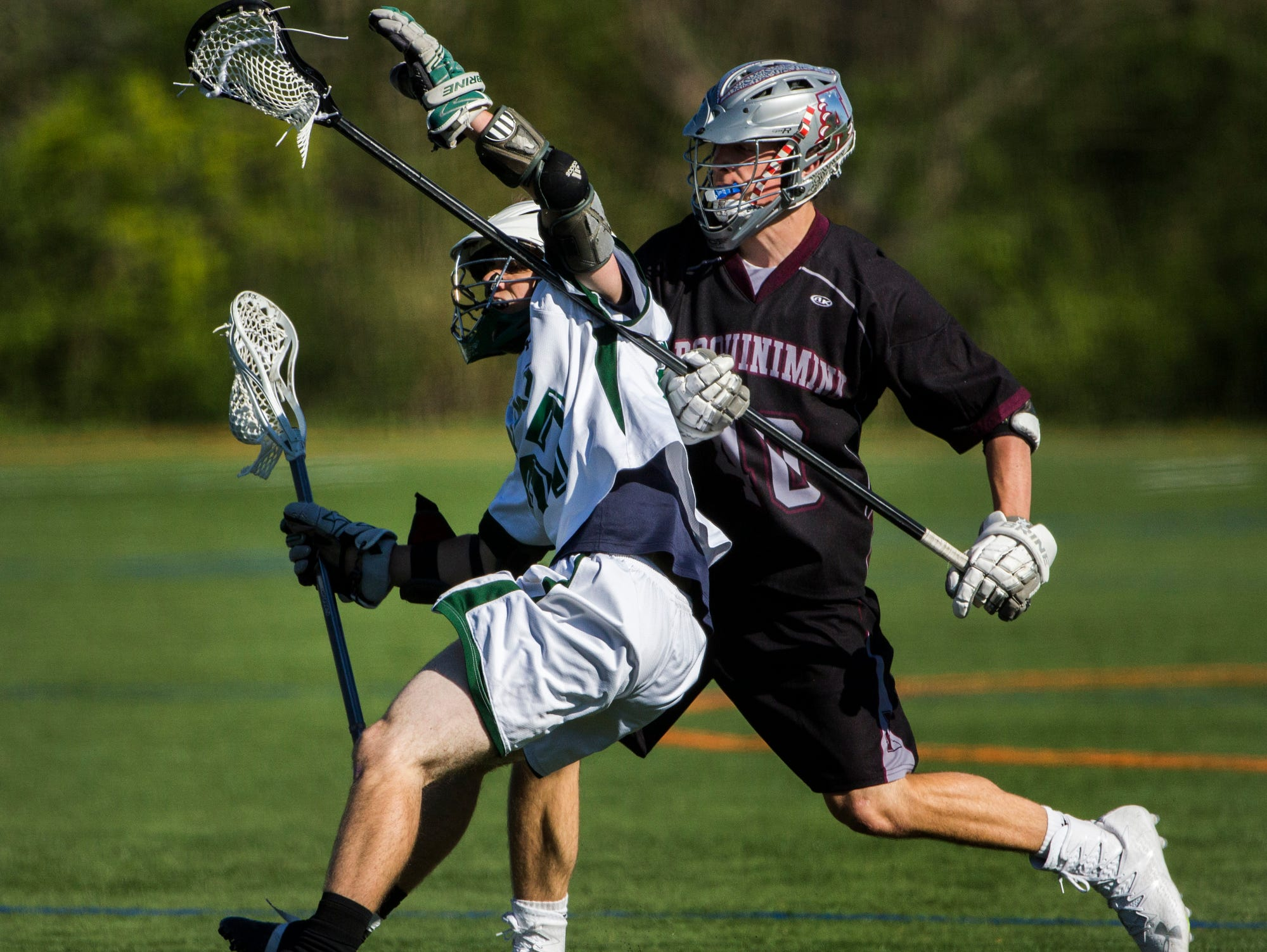 Archmere's Benjamin Revak (left) works against Appoquinimink's Dominic Berrera in the second quarter of Appoquinimink's 13-12 win over Archmere at Archmere Academy on Wednesday afternoon.