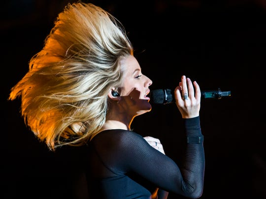 Ellie Goulding flips her hair back as she performs on the Main Stage at the Firefly Music Festival on Friday evening.