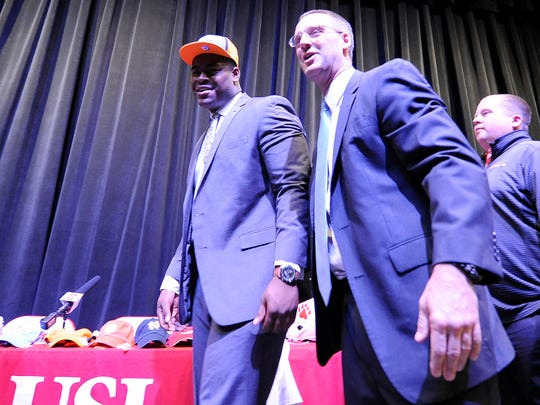 Trey Smith, left, and his coach Rusty Bradley smile after Smith's commitment announcement at University School of Jackson in Jackson, Tenn., on Tuesday, Dec. 6, 2016.