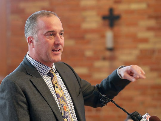 Brian Bruess, president-elect of St. Norbert College, addresses the audience gathered to welcome him Monday in Old St. Joseph Church on campus.