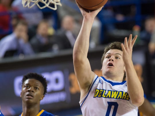 University of Delaware's Ryan Daly (0) with a shot attempt in their 56-58 loss to Hofstra University.