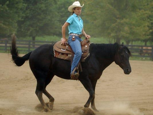 STACY WESTFALL WITH HORSE ROXY DEMONSTARTES BRIDLELESS REINING