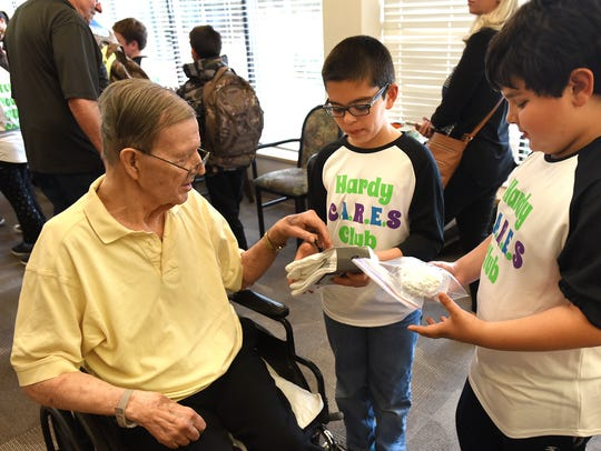 Hardy Elementary students Carter Carino, center, and