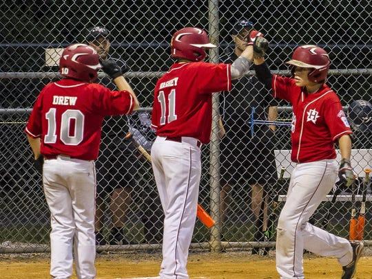 Holbrook's Garrett Drew (10) and RJ Vashey (11) congratulate