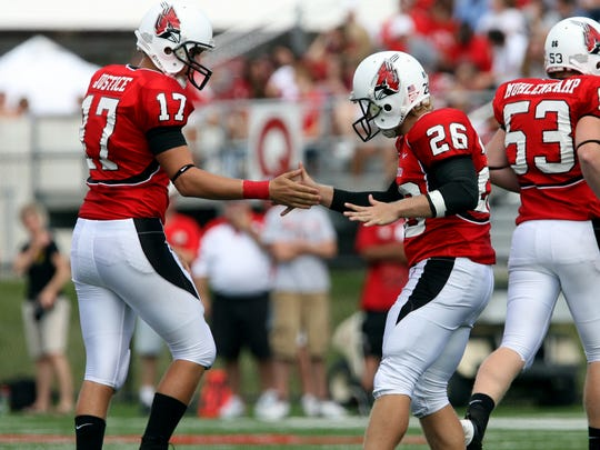 Ball State's Ian McGarvey (26) gets congratulated by Tanner Justice after making a field goal against Kent State in 2008.