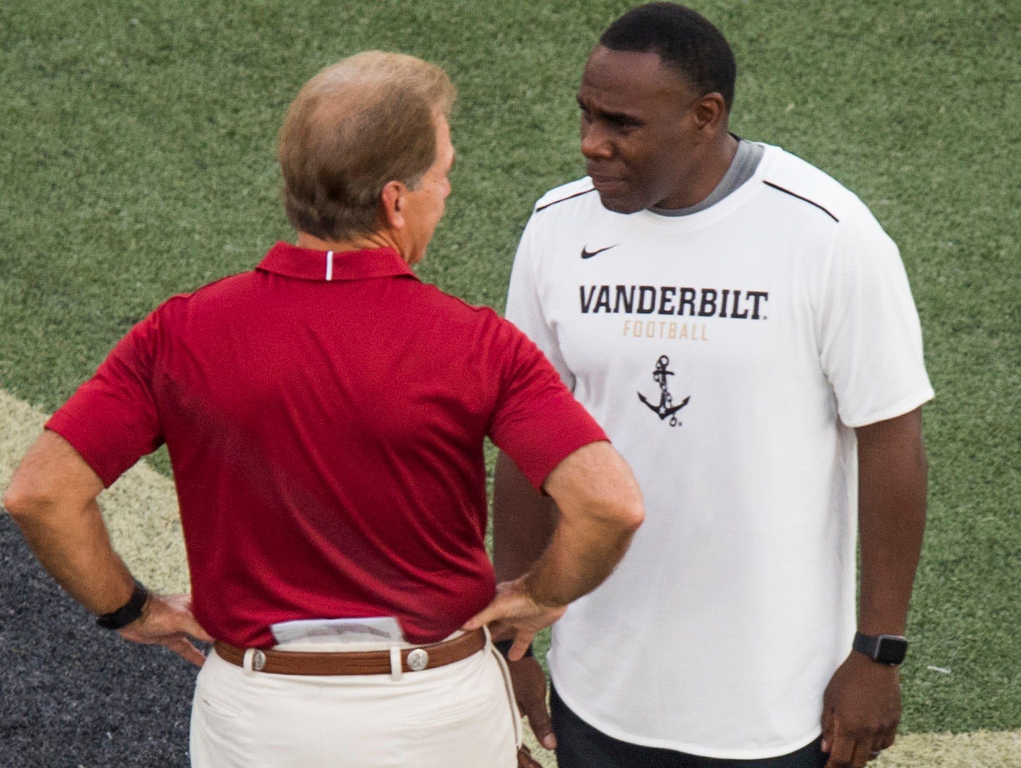 Alabama head coach Nick Saban chats with Vanderbilt head coach Derek Mason during warm ups at Vanderbilt Stadium in Nashville, Tenn. on Saturday September 23, 2017. (Mickey Welsh / Montgomery Advertiser)