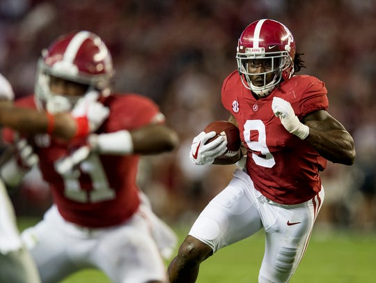 Alabama running back Bo Scarbrough carries against Ole Miss last season.