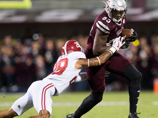 Alabama defensive back Anthony Averett (28) stops Mississippi State tight end Jordan Thomas (83) in first half action in Starkville, Ms. on Saturday November 11, 2017. (Mickey Welsh / Montgomery Advertiser)