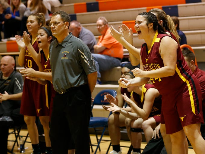 The McCutcheon bench erupts after Taylor Burns of Twin