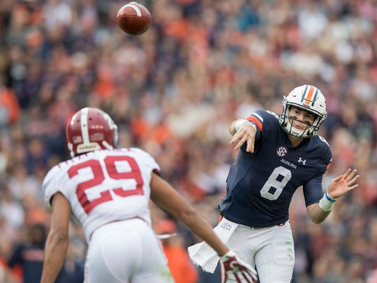 Auburn quarterback Jarrett Stidham (8) throws against Alabama in first half action in the Iron Bowl in Auburn, Ala. on Saturday November 25, 2017.