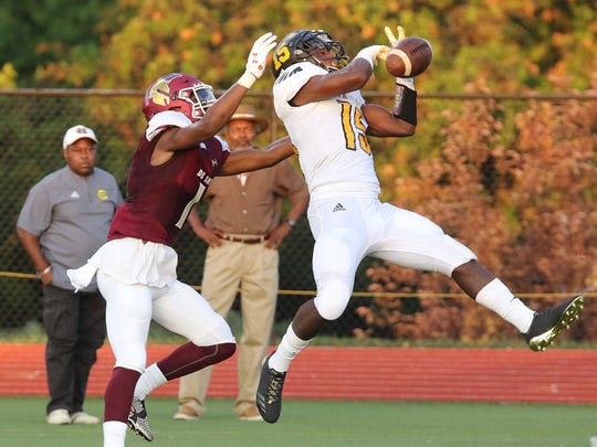 Missouri Hazelwood Central defensive back Dallas Craddieth (right) knocks down a pass intended for De Smet's Jordan Johnson during a game on Friday, August 18, 2017 at De Smet High School in Creve Coeur, Missouri. Paul Kopsky, STLhighschoolsports.com