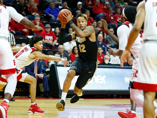 Purdue Boilermakers forward Vincent Edwards (12) drives
