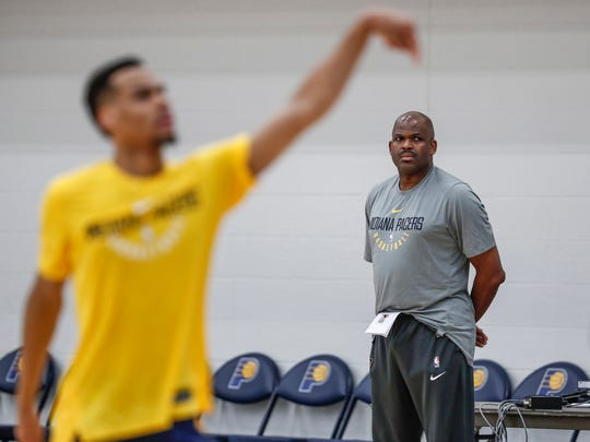 Pacers coach Nate McMillan, shown watching a pre-draft workout in June, works in concert with the front office to create what they believe is a unique culture.