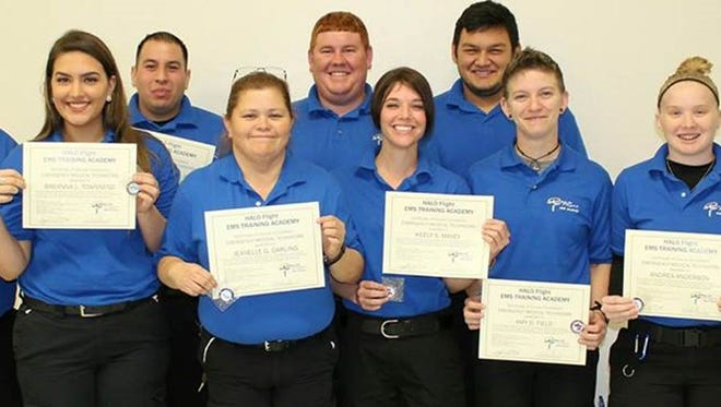"""From left, Eduardo Ordonez Jr., Breanna L. Townsend, David Hernandez Jr., Jeanelle P. Darling, Steven Z.W. """"Zachary"""" Roberson, Keely S. Maxey, Benny R. Clegg II, Amy Field, Andrea M. Anderson, and Wendy Greer, LP, academy director/coordinator"""