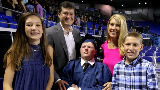 Baylor Bramble, surrounded by his family, was among the Siegel High School seniors that graduated at Murphy Center, on Friday, May 19, 2017. (L to R) Macy Bramble, David Bramble, Baylor Bramble, Christy Bramble and Brady Bramble.