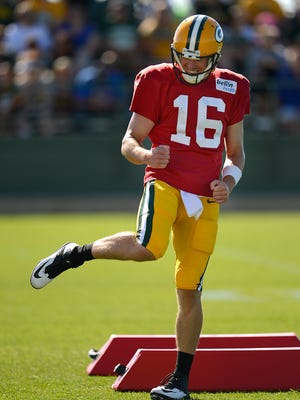 Green Bay Packers quarterback Scott Tolzien reacts after hitting a target while running passing drills during training camp practice at Ray Nitschke Field on Saturday, Aug. 1, 2015.