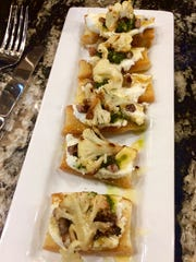 Caramelized cauliflower with pistachio pesto and honey on grilled focaccia at The Chef and I.