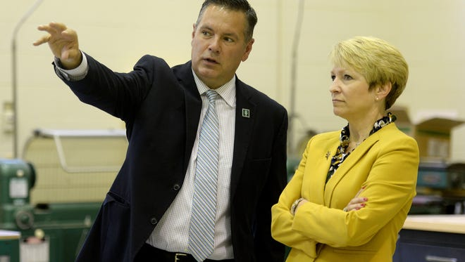 Ivy Tech Community College president-elect Sue Ellspermann, right, talks with Ivy Tech Richmond campus president Chad Bolser during a visit to the Richmond campus Friday, June 24, 2016.