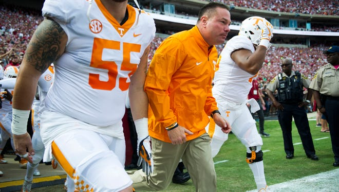 Tennessee Head Coach Butch Jones runs onto the field with players before the Tennessee vs. Alabama game at Bryant-Denny Stadium in Tuscaloosa, Alabama Saturday, Oct. 21, 2017.