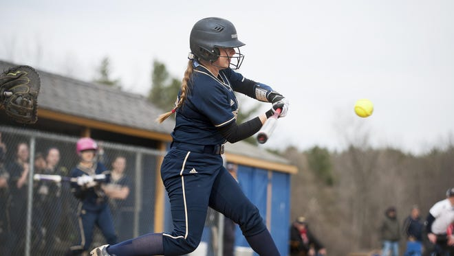 Essex's Victoria Bean (5) hits the ball during the high school softball game between the Mount Abraham Eagles and the Essex Hornets at Essex high school in April.